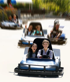pic of amusement park rides  - girls on go cart with a motion blur background - JPG
