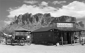 picture of carriage horse  - Old black and white Wild West Cowboy town with horse drawn carriage and mountains in background - JPG