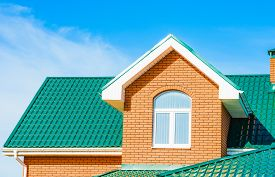 stock photo of gable-roof  - gable roof private residential new modern house with a window - JPG