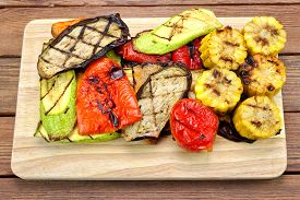 stock photo of braai  - Grilled Vegetables On The Cutting Board - JPG