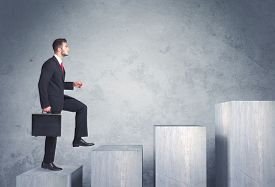 pic of step-up  - Business person stepping up a staircase - JPG