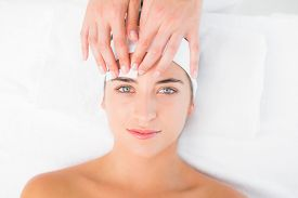 image of eyebrows  - Close up of a hand waxing beautiful womans eyebrow - JPG