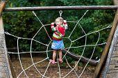 Child Having Fun On School Yard Playground poster