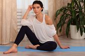 Fitness Woman Sitting At Home. Female In Sportswear Doing Meditation On Exercise On Mat In Living Ro poster