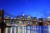 stock photo of new york skyline  - Brooklyn Bridge and Manhattan skyline At Night - JPG