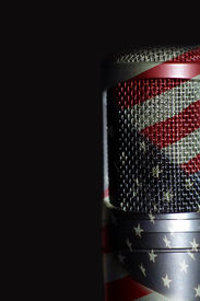 stock photo of freedom speech  - an american flag over a large diaphram microphone