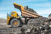 Large Quarry Dump Truck. Loading The Rock In Dumper. Loading Coal Into Body Truck. Production Useful poster