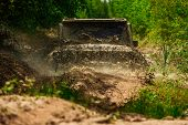 Mud And Water Splash In Off-road Racing. Tracks On A Muddy Field. Expedition Offroader. Track On Mud poster