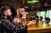 Men Drinking Beer Together. Hipster Brutal Man Drinking Beer With Friend At Bar Counter. Men Drunk R poster