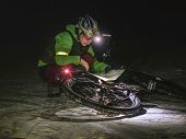 Woman Biker Travel In Extreme Night Snowy Nature.  Sport And Healthy Life. Extreme Sports. poster