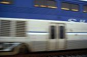 stock photo of amtrak  - The Amtrak Pacific Surfliner streaks through a California town - JPG
