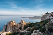 Coast Of Corsica Viewed From Rocky Outcrop poster