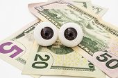 Pair Of The Eyes (eyeballs) Lie On Money (dollars) And Look At Object. Money Is Tracking You, Watch  poster