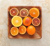 Oranges Whole And Cut In Half On A Wood Tray. Background From Usual Oranges And Sicilian Red Bloody poster