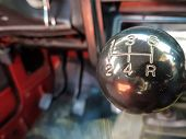 Car Shift Knob With Speed Numbers. Closeup Of A Car 5 Speed Gearstick. poster