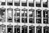 Glass Grey Square Windows Of Modern City Business Building Skyscraper. Glass Balconies In The Buildi poster