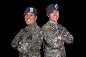 stock photo of army soldier  - Two military guards pose for a shot before departing overseas - JPG