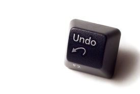 pic of keyboard keys  - An undo button from computer keyboard on white isolated background - JPG