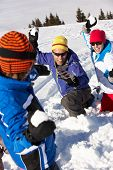 stock photo of snowball-fight  - Family Having Snowball Fight On Ski Holiday In Mountains - JPG