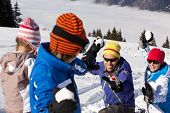 image of snowball-fight  - Family Having Snowball Fight On Ski Holiday In Mountains - JPG