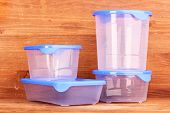 stock photo of tupperware  - Plastic containers for food on wooden background - JPG