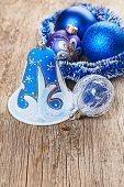 image of shaky  - Christmas decorations on old wooden background - JPG