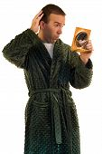 foto of housecoat  - A young male looking at himself in a mirror - JPG