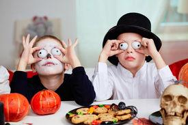 foto of antichrist  - Photo of two eerie boys frightening people on Halloween - JPG