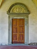 Renaissance Door In The Cloister Of Basilica Di Santa Croce. Florence, Italy