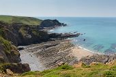 image of promontory  - Rock strata on rocky beach Hartland Point Devon England - JPG