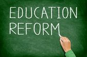 Education reform - school reform concept blackboard. Teacher or student writing EDUCATION REFORM on