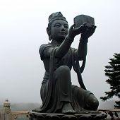 stock photo of lantau island  - Buddhist Statue praising the Big Buddha  - JPG