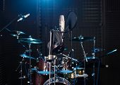 picture of drum-set  - Studio room with drum set microphones and recording equipment.