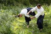 picture of aikido  - Training martial art Aikido. On nature. outdoors.