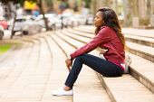 pic of thoughtfulness  - thoughtful young african woman sitting outdoors - JPG