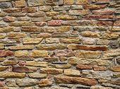 pic of gneiss  - Colorful stone wall closeup in sunny day