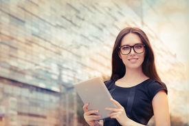 stock photo of high-rise  - Woman wearing glasses - JPG
