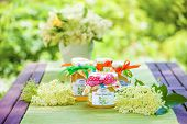 pic of elderflower  - Glasses with elderflower flower jelly in the garden - JPG