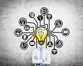 stock photo of lightbulb  - businessman with lightbulb head and drawing icon on wall - JPG