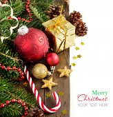 stock photo of candy cane border  - Festive decorations with baubles and candy cane on wood - JPG