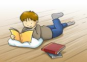 picture of bookworm  - Kid a boy reading a book lying on the floor - JPG