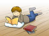 foto of bookworm  - Kid a boy reading a book lying on the floor - JPG