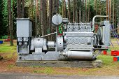 picture of dynamo  - Old engine and electricity generator in the Grutas park near Druskininkai town - JPG