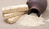 stock photo of sunflower-seeds  - Kozinaki sesame seeds and sunflower seeds from a jug - JPG