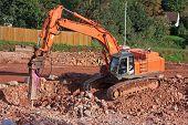 foto of breaker  - rock breaker working on a road construction site - JPG