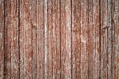 pic of red siding  - Old gray wooden wall with damaged red paint layer background photo texture - JPG