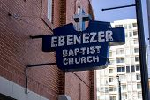 stock photo of king  - A blue and white sign marks the home of Ebenezer Baptist Church where Martin Luther King Jr - JPG