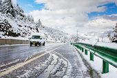 stock photo of slippery-roads  - Drive car on slippery road from melt snow - JPG