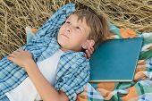 image of poetry  - Teenage boy is dreaming inspired by book - JPG
