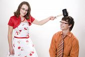 pic of adversity humor  - Young pretty wife strikes her husband in studio - JPG